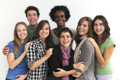 Happy group of young students. Happy group of young college or university students on white background Stock Photos