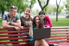 Happy group of young students sitting Royalty Free Stock Photos