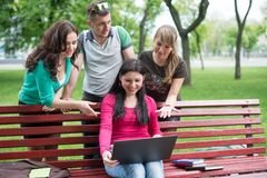 Happy group of young students sitting Stock Image