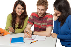 Happy Group Of Young Students Studying Stock Photography