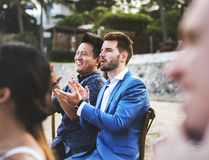 Happy guests at a beach wedding stock photography