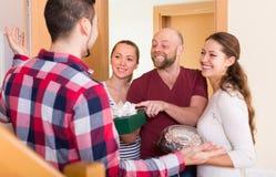 Happy guests in doorway Stock Photos