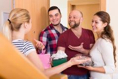 Happy guests in doorway Stock Photo