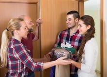 Happy guests in doorway Stock Image
