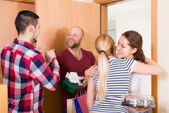 Happy guests in doorway Royalty Free Stock Images