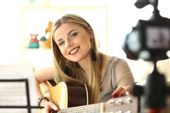 Happy Guitar Performer Recording Musical Vlog royalty free stock photography