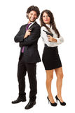 Happy with guns. A businessman and a businesswoman (or maybe a couple of spies or gangster) holding guns over a white background Stock Photo