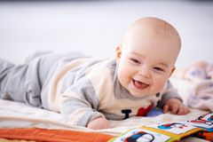 Happy gurgling baby lying on his bed Royalty Free Stock Photo