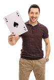 Happy guy with an ace of spades card. Isolated on white background Stock Image