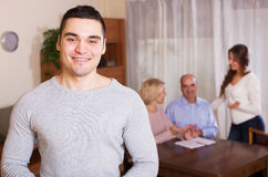 Happy guy and big family with agent Royalty Free Stock Images