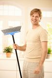 Happy guy with broomstick Royalty Free Stock Images