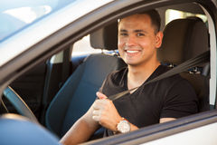 Happy guy buckling up royalty free stock images