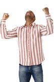 Happy guy celebrating good news Stock Photo