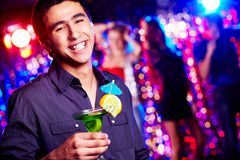 Happy guy with cocktail Royalty Free Stock Image