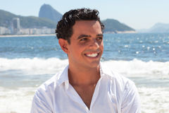 Happy guy at Copacabana beach at Rio de Janeiro Stock Photos