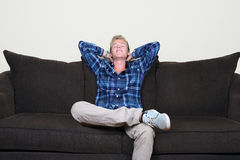 Happy guy on couch Royalty Free Stock Photos