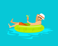 Happy guy floating in inflatable ring in the swimming pool, Stock Photo