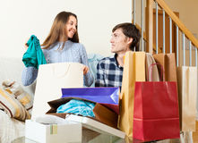 Happy guy and girl discussing purchases Stock Photos