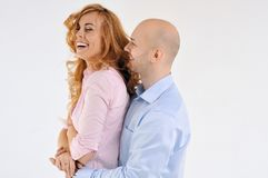Happy guy and girl. Girl is hugging the boy. Beautiful happy couple. Love story. Family photo Stock Photo