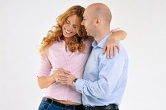 Happy guy and girl. Girl is hugging the boy. Beautiful happy couple. Love story. Family photo Stock Photos