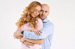 Happy guy and girl. Girl is hugging the boy. Beautiful happy couple. Love story. Family photo Royalty Free Stock Photos