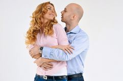 Happy guy and girl. Girl is hugging the boy. Beautiful happy couple. Love story. Family photo Stock Image