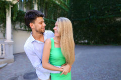 Happy guy and girl posing for photo, looking into each others ey Stock Photography