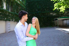 Happy guy and girl posing for photo, looking into each others ey Royalty Free Stock Image