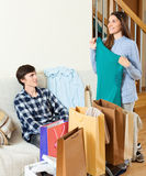 Happy guy and girl with purchases Stock Photos