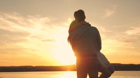 Happy guy and girl waltz in the evening in the summer park. Loving man and woman dance in bright rays of sun on the stock footage