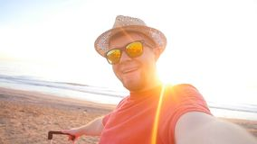 Guy in hat gets a selfie during his vacation at sea. Happy Guy in hat gets a selfie during his vacation at sea stock footage