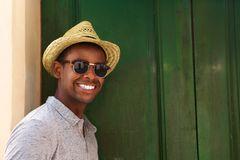 Happy guy with hat and sunglasses Stock Images