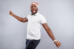 Happy guy having fun on Christmas day Stock Photos
