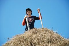 The happy guy on a haystack Royalty Free Stock Images