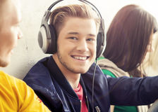 Happy guy in a headphones Royalty Free Stock Photos