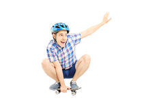 Happy guy with helmet skating on a skate board Royalty Free Stock Photos