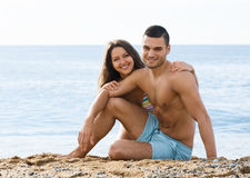 Happy guy and his girlfriend  on sand beach Royalty Free Stock Photography