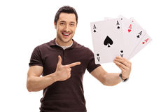 Happy guy holding four aces and pointing Royalty Free Stock Photo