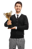 Happy guy holding a golden cup Stock Images