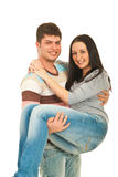 Happy guy holding woman in his arms Royalty Free Stock Photography