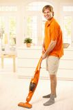 Happy guy with hoover Royalty Free Stock Photos