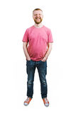 Happy guy in jeans and a T-shirt Stock Images