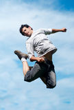 Happy guy jumping Stock Image