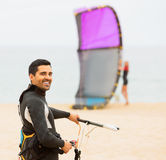 Happy guy with kiteboardon at the beach Royalty Free Stock Images