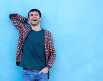 Happy guy laughing against blue background Royalty Free Stock Image