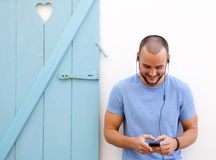 Happy guy listening to music on mobile phone Stock Images