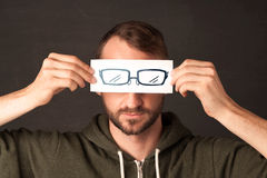 Happy guy looking with paper hand drawn eye glasses Royalty Free Stock Photos