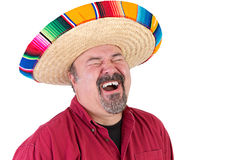 Happy Guy with Mexican Sombrero  Hat. Happy guy with sombrero hat laughing out loud with his eyes closed Royalty Free Stock Photo