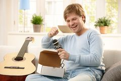 Happy guy with microphone Royalty Free Stock Photos