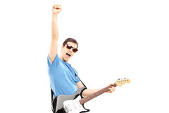 Happy guy playing on an electric guitar Stock Photo